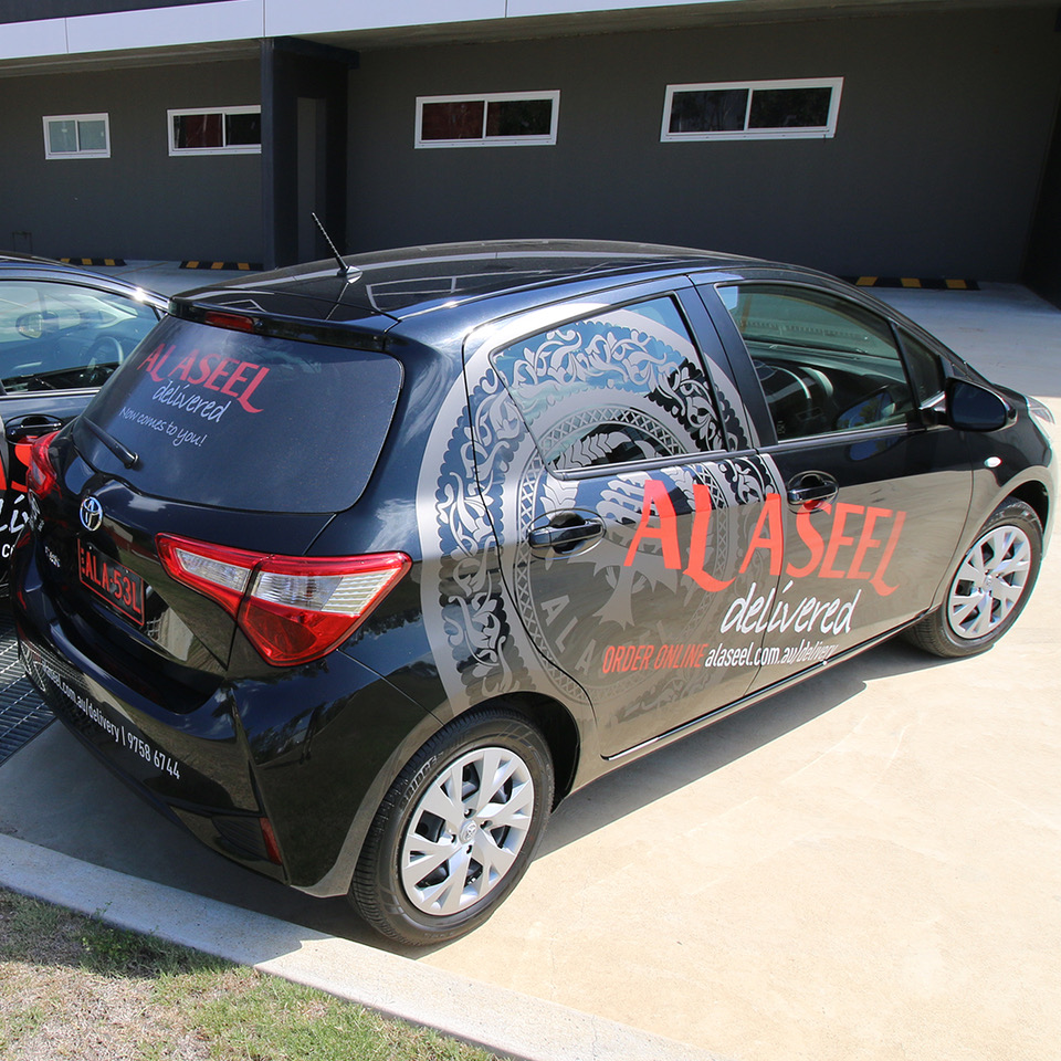 al aseel, delivery, toyota, yaris , vehicle, signage